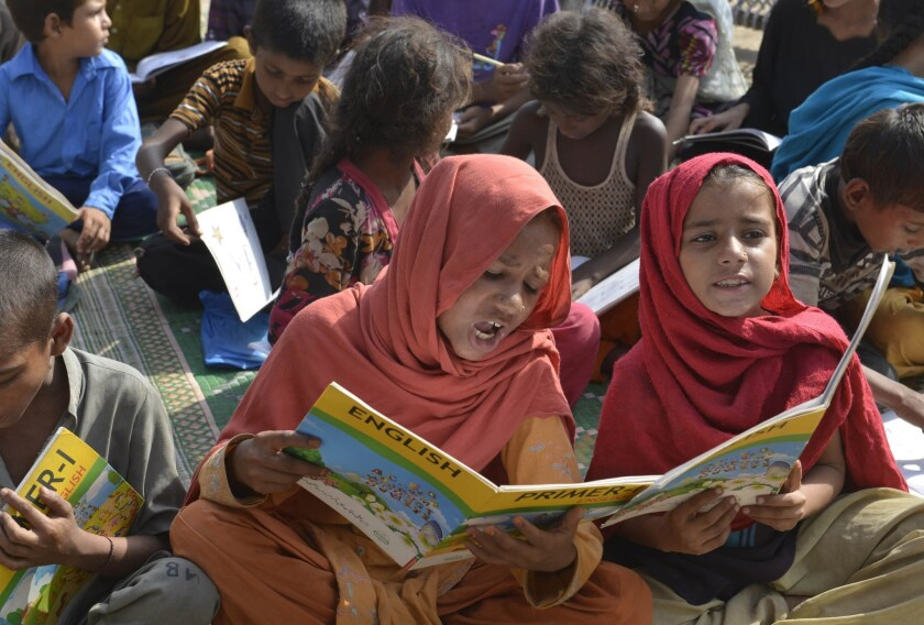 Pakistani children attend a class at a makeshift school on International Literacy Day in Lahore on September 8, 2015.