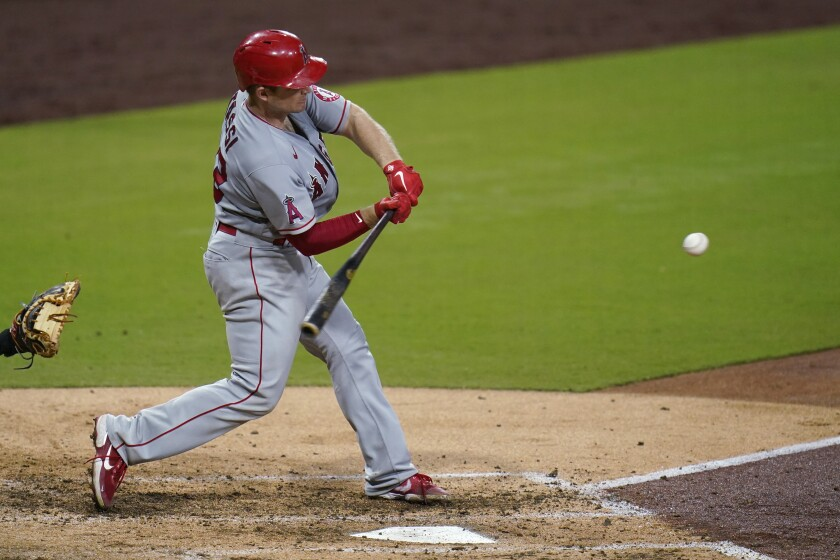 Los Angeles Angels' Max Stassi hits a two-run home run during the sixth inning of the team's baseball game against the San Diego Padres, Tuesday, Sept. 22, 2020, in San Diego. (AP Photo/Gregory Bull)
