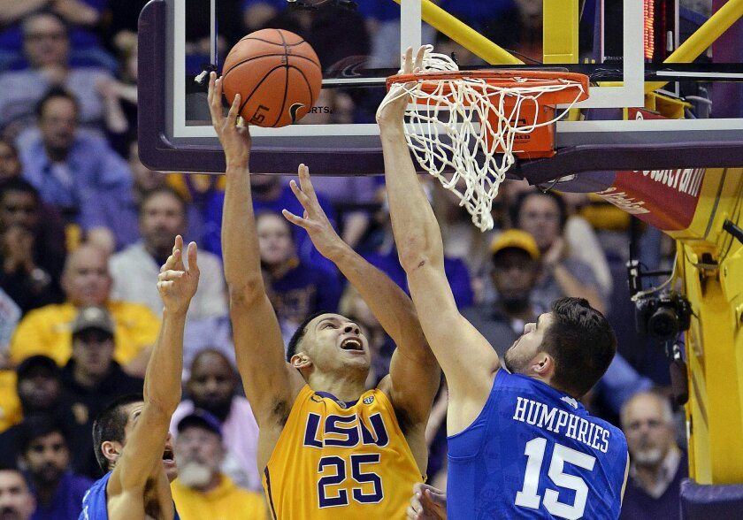 FILE - In this Jan. 5, 2016, file photo, LSU forward Ben Simmons (25), of Australia, puts the ball up for two points in heavy traffic between Kentucky forwards Derek Willis (35) and Isaac Humphries (15) during the second half of an NCAA college basketball game in Baton Rouge, La. Although LSU added the likely No. 1 overall draft pick in Simmons, the SEC could have a tough time matching last season's total of five NCAA Tournament bids. (AP Photo/Bill Feig, File)