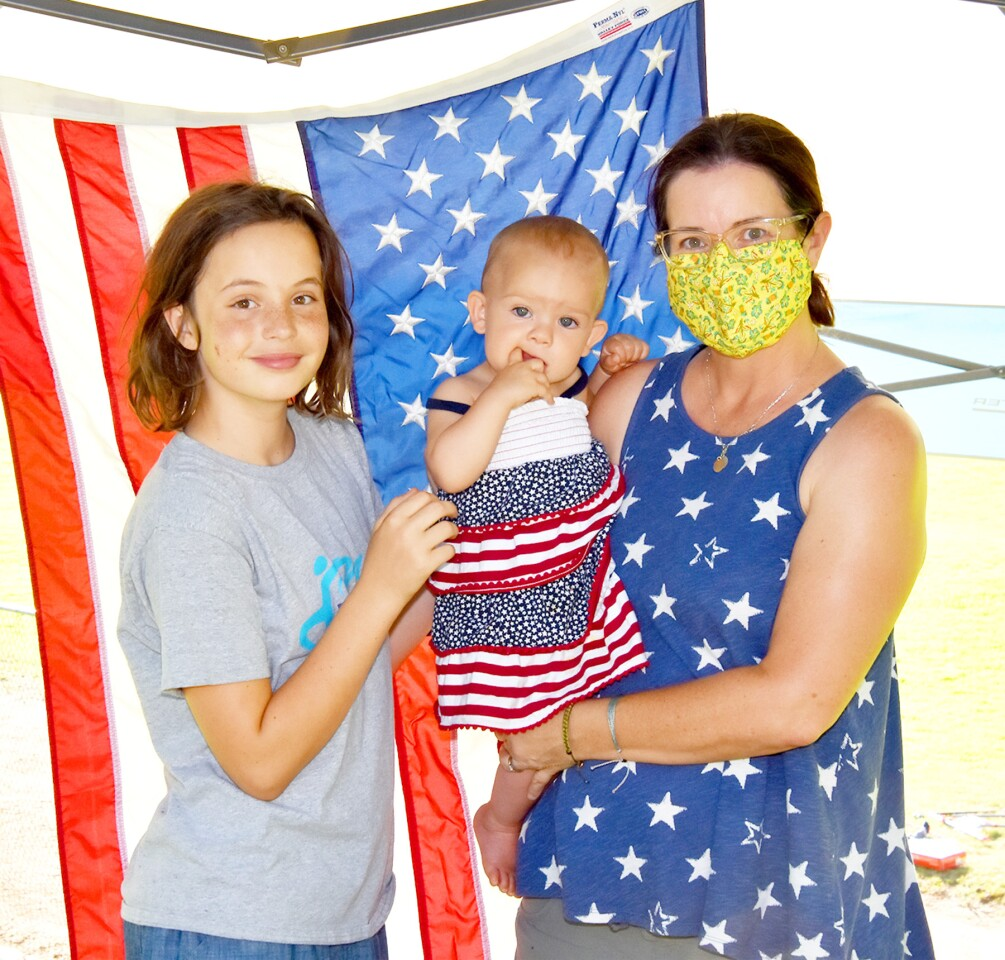 Sam, Lanet and Nichole Peterson were among those who gathered at Lake Poway several hours before the Fourth of July fireworks show on Saturday.
