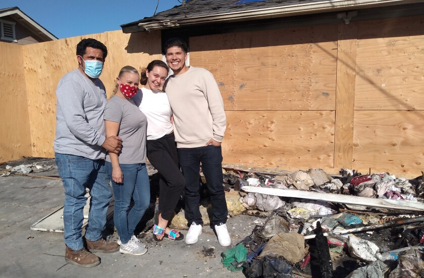 Fire survivors are, from left, Nestor Hernandez and his wife Stacy, their daughter Haley, and rescuer Nick Espinoza.