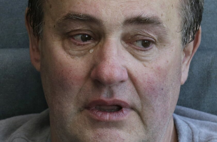 Thomas Manning, of Halifax, Mass., sheds tears while speaking of his surgical ordeal as he prepares to be discharged from Massachusetts General Hospital, Wednesday, June 1, 2016, in Boston. Manning is the first man in the United States to undergo a penis transplant. (AP Photo/Elise Amendola)