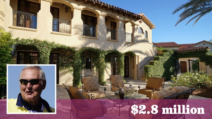 Professional golfer Fred Couples has sold his home in La Quinta to Lakers great Jerry West, shown, for $2.8 million.