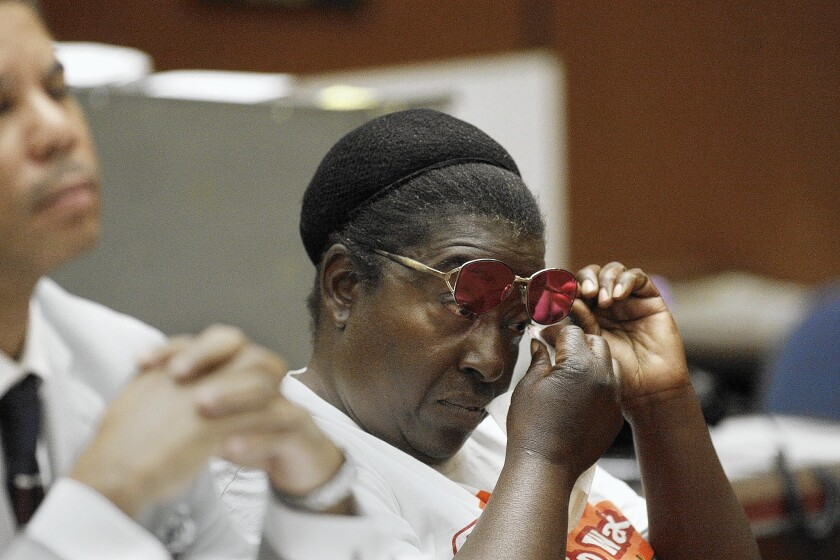 Annie Moody wipes her eye during a hearing at a downtown L.A. courthouse. Authorities say she has turned down dozens of offers of shelter or services for the homeless. Friends believe police target her because she stands up for her rights.
