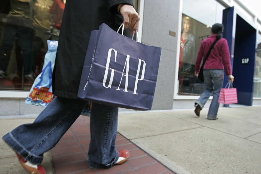 A customer leaves a Gap store in Palo Alto on Feb. 8, 2007.