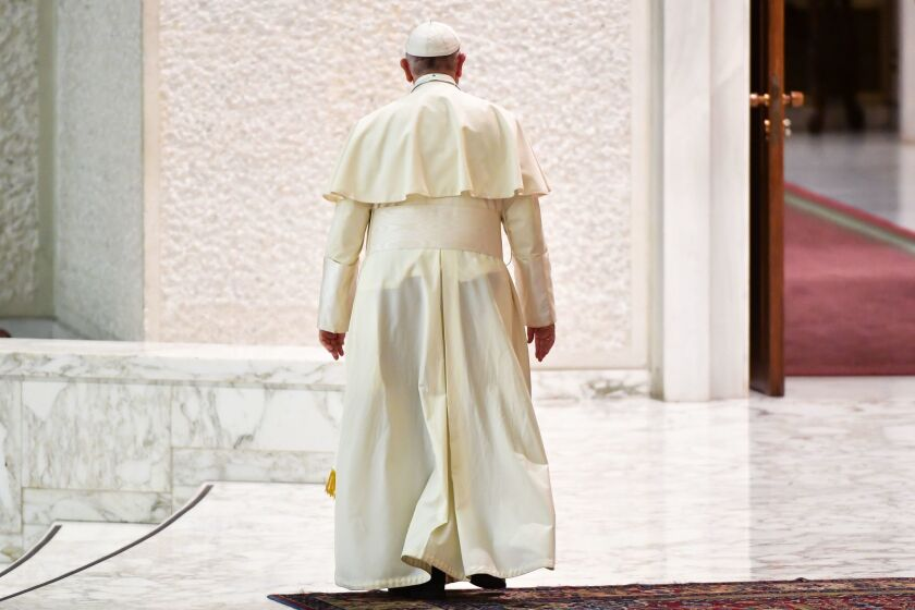 Pope Francis leaves at the end of his audience of participants in the National Congress of the Italian Masters of Labor Federation at the Vatican on June 15, 2018.