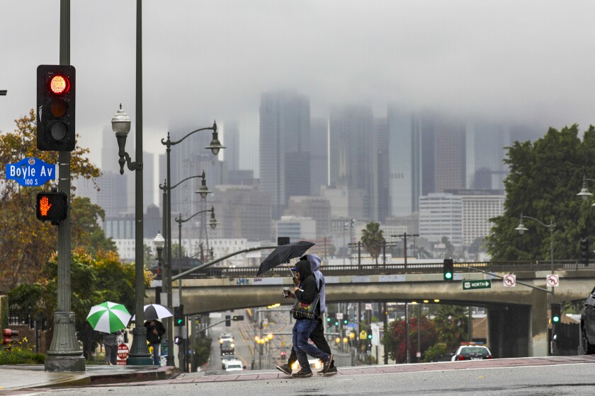 Los Angeles skyline shrouded in clouds on Wednesday during steady rain
