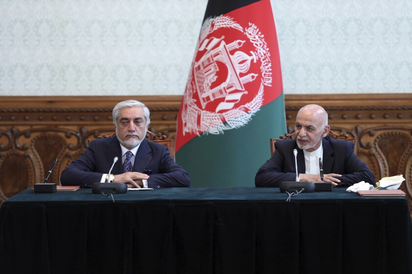 Afghan President Ashraf Ghani, right, and political rival Abdullah Abdullah announced a power-sharing agreement Sunday in Kabul.