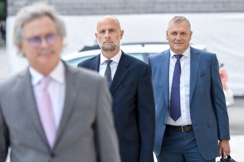 Former Fifa general secretary Jerome Valcke, right, and his lawyers arrive at the Federal Criminal Court in Bellinzona, Switzerland, Monday, September 14, 2020. Valcke is accused of qualified disloyalty and incitement, falsification of documents and passive bribery. The Office of the Attorney General of Switzerland opened the proceedings in March 2017. (Francesa Agosta/Keystone/Ti-Press via AP)