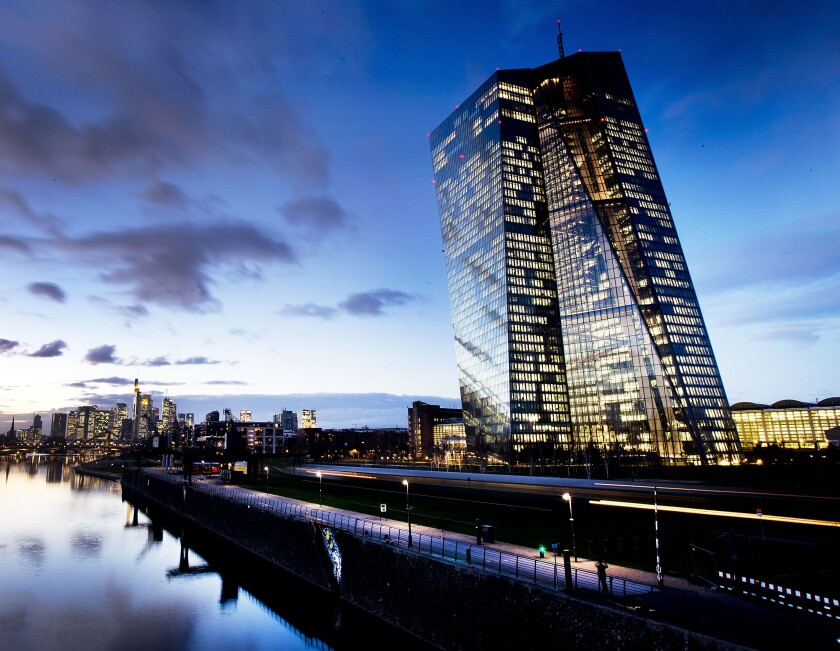In this Tuesday, Dec. 11, 2018 photo the European Central Bank (ECB) sits next to the river Main in Frankfurt, Germany. The European Central Bank has boosted its pandemic emergency support program by 600 billion euros to 1.35 trillion euros ($1.5 trillion) in an effort to keep affordable credit flowing to the economy during the steep downturn caused by the virus outbreak. (AP Photo/Michael Probst, file)