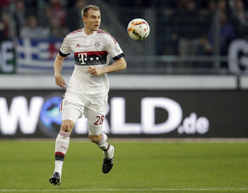 FILE - In this Dec. 19, 2015 file  picture Bayern's Holger Badstuber plays the ball during the German Bundesliga soccer match between Hannover 96 and FC Bayern Munich in Hannover, Germany.  Pep Guardiola's dream of leading Bayern Munich to the treble in his last season in charge for a perfect farew