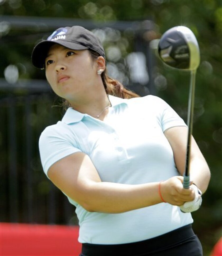 Mindy Kim, of Diamond Bar, Calif., drives off the first tee during the first round of the LPGA State Farm Classic golf tournament in Springfield, Ill., Thursday, June 9, 2011. (AP Photo/Seth Perlman)