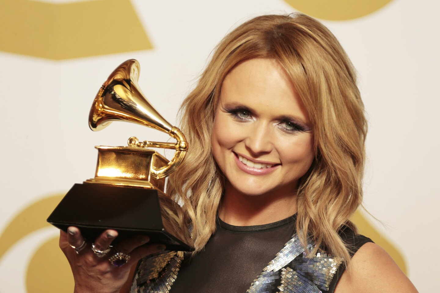 """Miranda Lambert with her Grammy Award for country album for """"Platinum."""" 