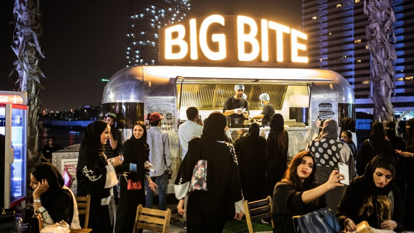 ONE TIME USE - Food trucker Aziz catering to his customers at the O'hara event, Jeddah, Saudi Arabia