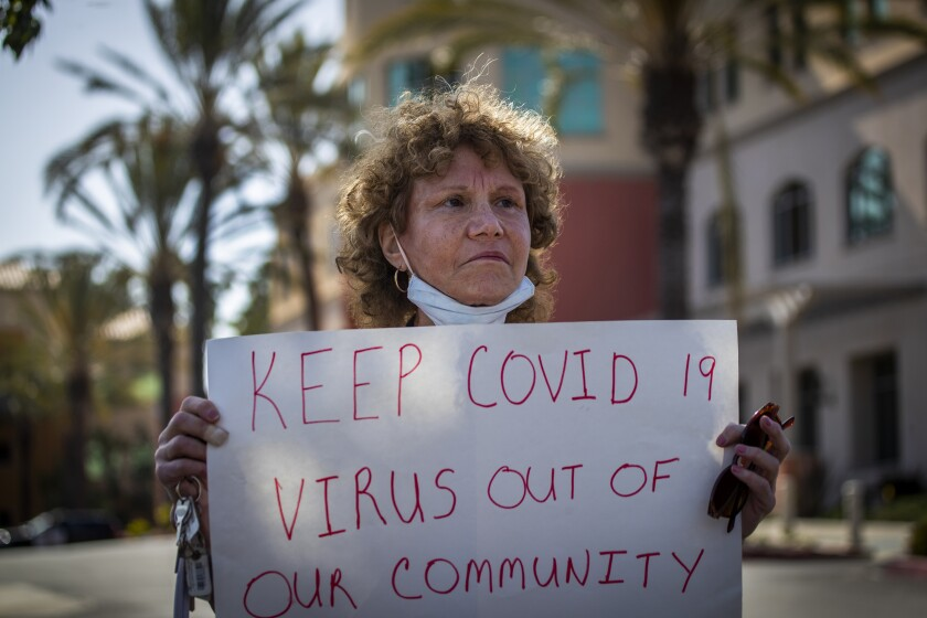 O.C. residents protest use of hotel to treat homeless people with the coronavirus
