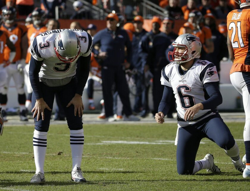 New England Patriots punter Ryan Allen (6) looks on as Patriots kicker Stephen Gostkowski reacts after missing an extra point following a touchdown by Steven Jackson during the first half the NFL football AFC Championship game between the Denver Broncos and the New England Patriots, Sunday, Jan. 24, 2016, in Denver. (AP Photo/Chris Carlson)