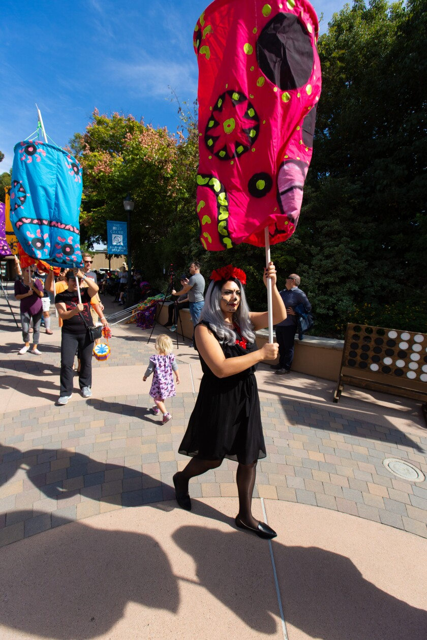 The Old Globe Theatre's Day of the Dead celebration includes a mini-parade.