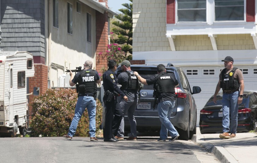 Heavily armed San Diego police officers retreated from the home of 19-year-old John T. Earnest, who is a suspect in the shooting of four people in a Poway synagogue on April 27, 2019.