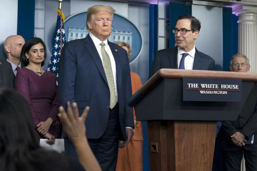 President Trump and Treasury Secretary Steven T. Mnuchin, at lectern, during a news briefing with the coronavirus task force at the White House on Tuesday.
