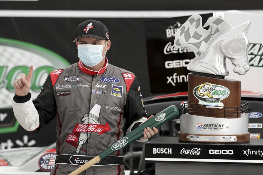 Cole Custer celebrates with the trophy after winning a NASCAR Cup Series race on Sunday in Sparta, Ky.