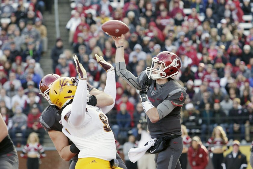 Washington State quarterback Luke Falk (4) passes during the first half of an NCAA college football game against Arizona State, Saturday, Nov. 7, 2015, in Pullman, Wash. (AP Photo/Young Kwak)