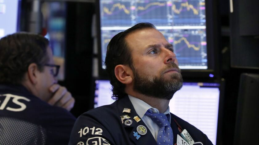Specialist Michael Pistillo on the floor of the New York Stock Exchange in early January.
