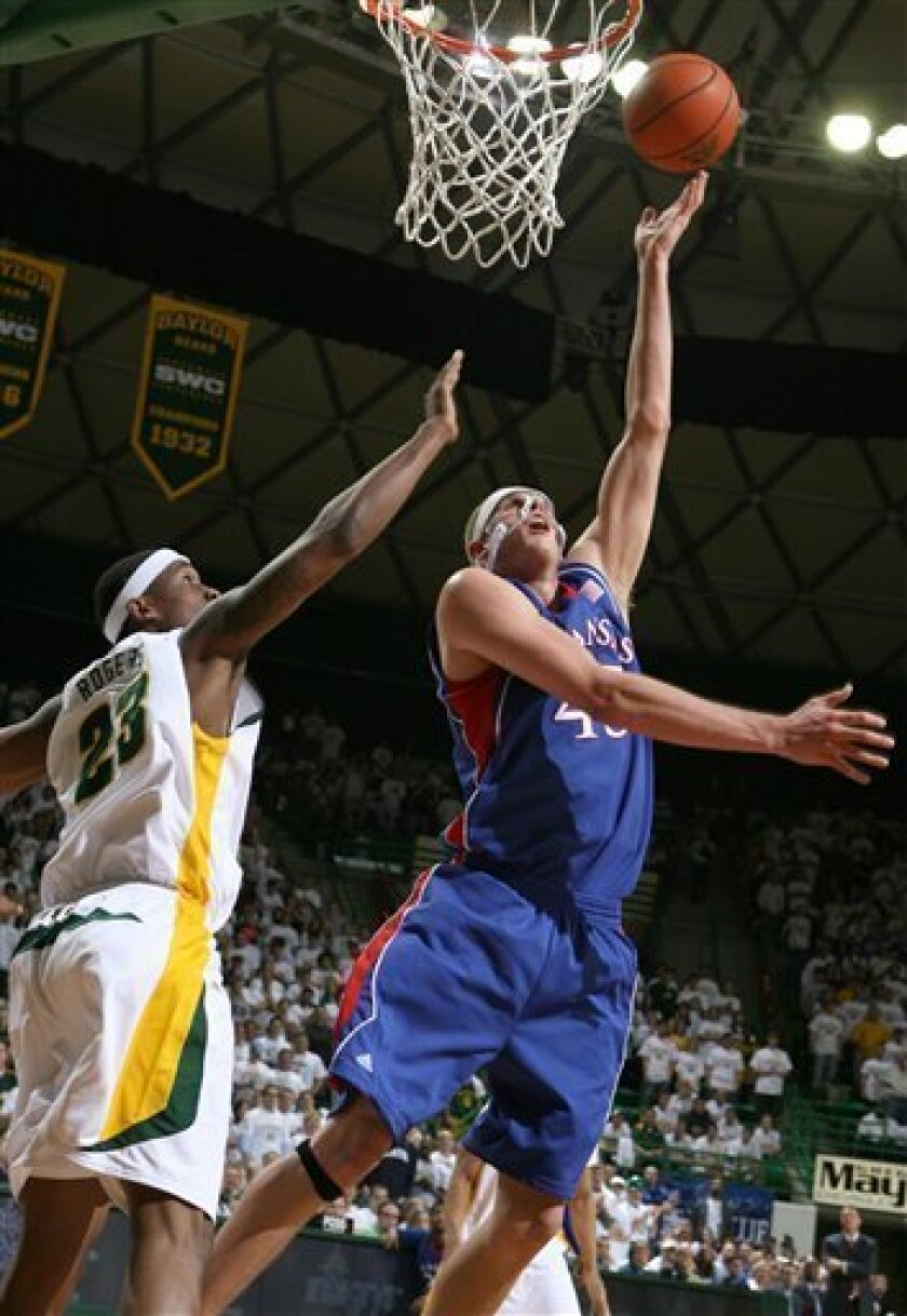 Kansas center Cole Aldrich (45) lays up in front of Baylor's Kevin Rogers (23) in first half action of an NCAA college basketball game Monday Feb. 2, 2009 in Waco, Texas. (AP Photo/Duane A. Laverty)