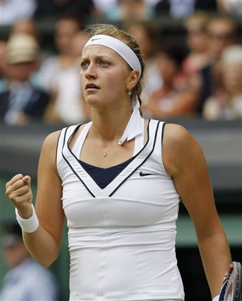 Petra Kvitova of the Czech Republic celebrates a point win against Russia's Maria Sharapova during the ladies' singles final at the All England Lawn Tennis Championships at Wimbledon, Saturday, July 2, 2011. (AP Photo/Anja Niedringhaus)