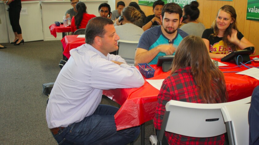 Rep. David Valadao (R-Hanford) speaks with high school interns at his Hanford campaign office.