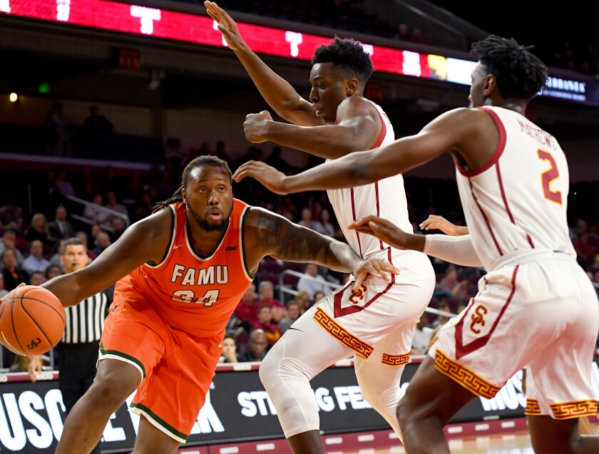 USC's Onyeka Okongwu and Jonah Mathews (2) try to slow down Florida A&M's Evins Desir during the Trojans' season-opening win Nov. 5 at Galen Center.