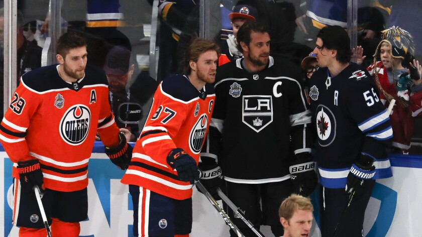 The Kings' Anze Kopitar, second from right, chats with fellow players before the NHL All-Star skills event Jan. 24, 2020.