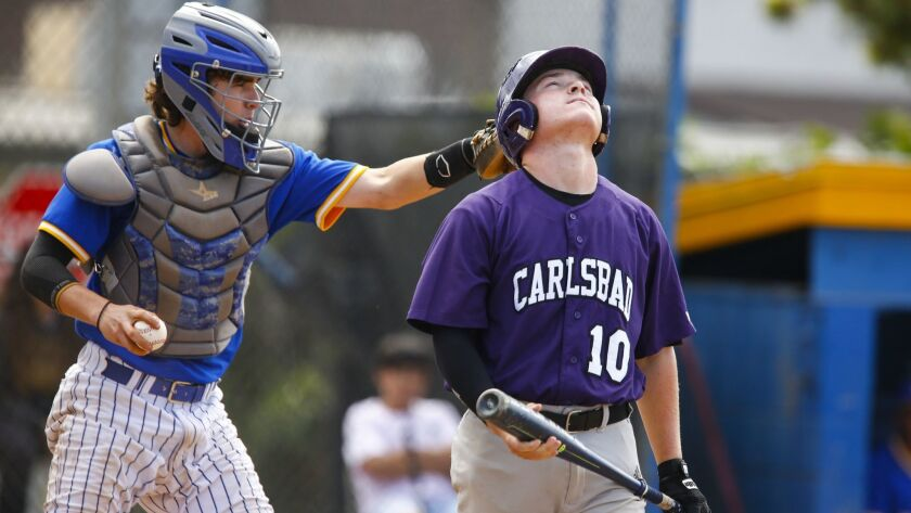 Carlsbad catcher Nash Johnson reacts to a first inning strikeout by Grossmont pitcher Jack Hyde.