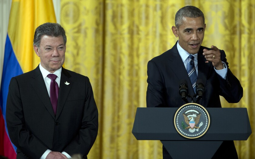 President Obama, with Colombian President Juan Manuel Santos, speaks at a reception for Plan Colombia, the U.S. aid program for Colombia, in the White House on Thursday.