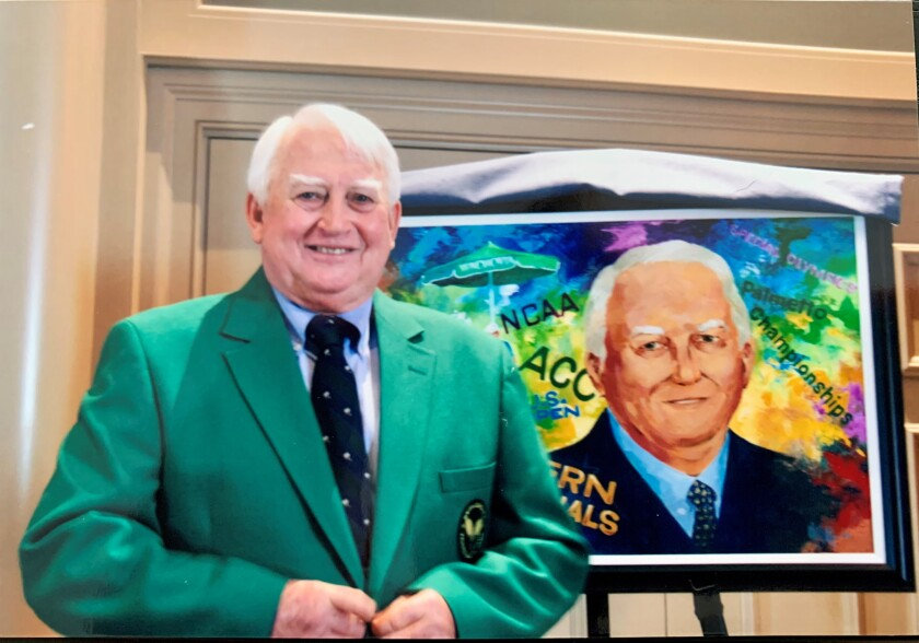 Carey Alexander Washington in a green jacket stands in front of an illustration of himself.