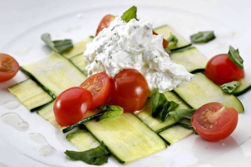 Woven zucchini with fresh goat cheese.