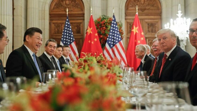 President Trump dines with Chinese President Xi Jinping during last month's G-20 summit in Buenos Aires.