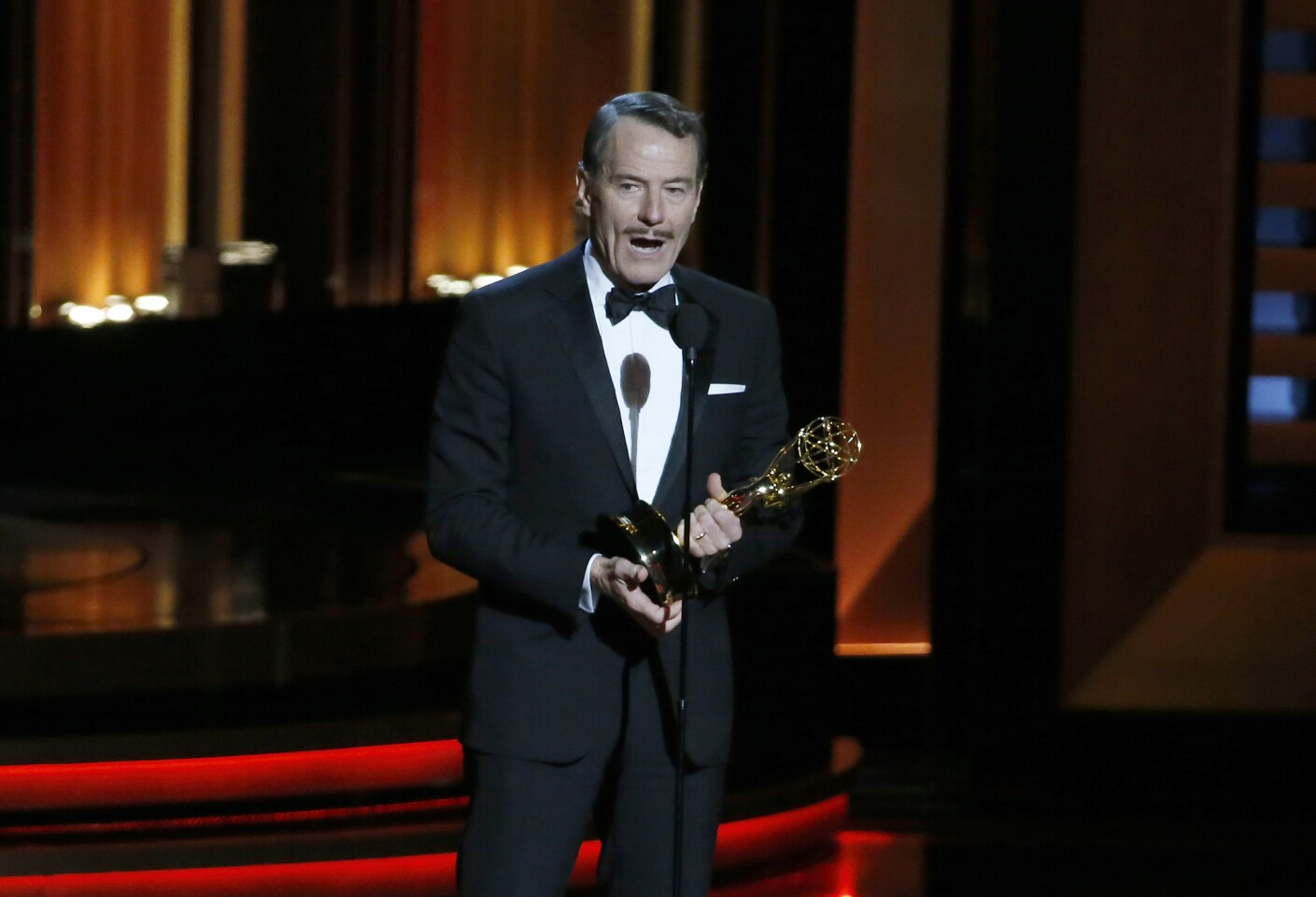 """Bryan Cranston of """"Breaking Bad"""" wins the lead actor in a drama, his fifth Emmy win. """"I love to act, it is a passion of mine and I will do it until my last breath,"""" Cranston says. He dedicates the award to all the """"Sneaky Petes,"""" a nickname his family gave him because of his manipulative ways as a young child."""