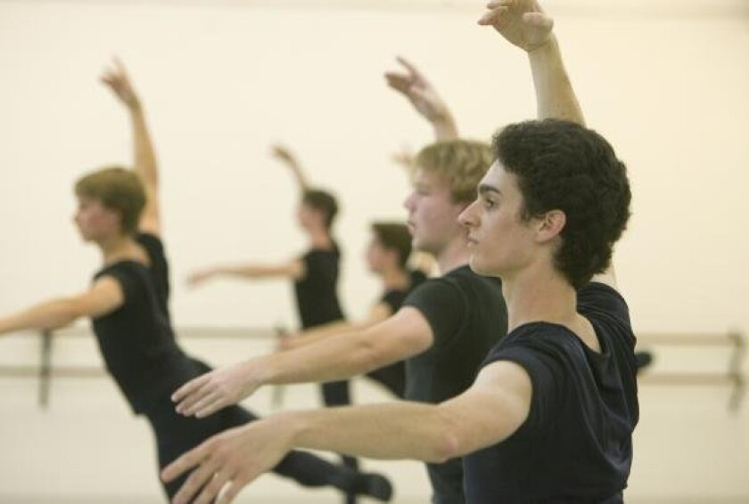 "Vincent Padilla (right) rehearses with other students at the Academy of Ballet for the ""Nutcracker."""