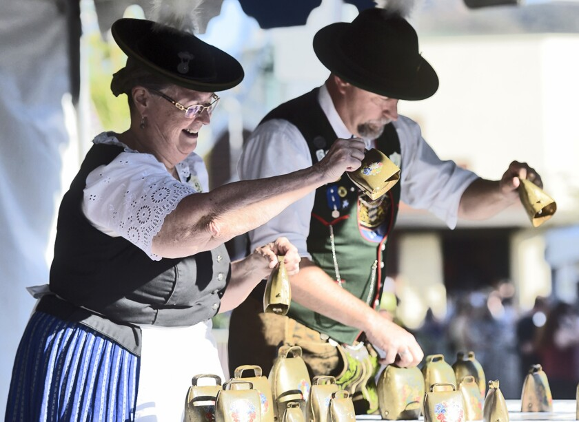 Theresa, left, and Fred Volland of the D'Oberlander Dancers perform German music using cow bells as