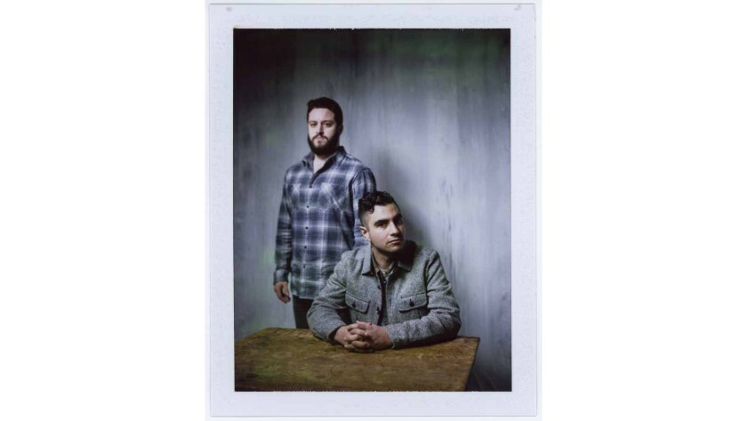 """Director Adam Bhala Lough, seated, and Cody Wilson from the film """"The New Radical."""""""