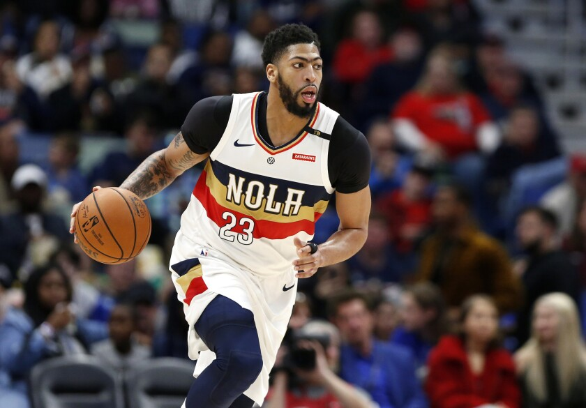 FILE - In this March 16, 2019, file photo, New Orleans Pelicans forward Anthony Davis brings the bal