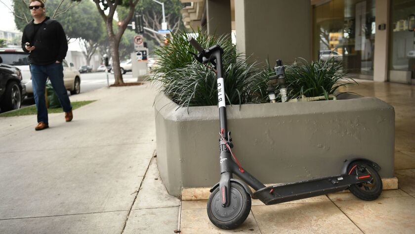 A Bird scooter stands along 5th Avenue in Santa Monica.