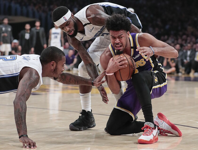 Lakers guard Quinn Cook grabs a loose ball against Orlando.
