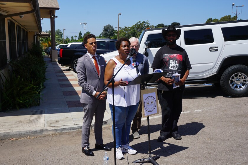 Community leaders hold a press conference outside the offices of STAR/PAL on Wednesday after meeting about the use of Sheriff's Department buses to transport children to a field trip. (Left to right) President of the People's Alliance for Justice Rev. Shane Harris, Vice President of NAACP San Diego Francine Maxwell, Herman Collins and Henry Wallace.