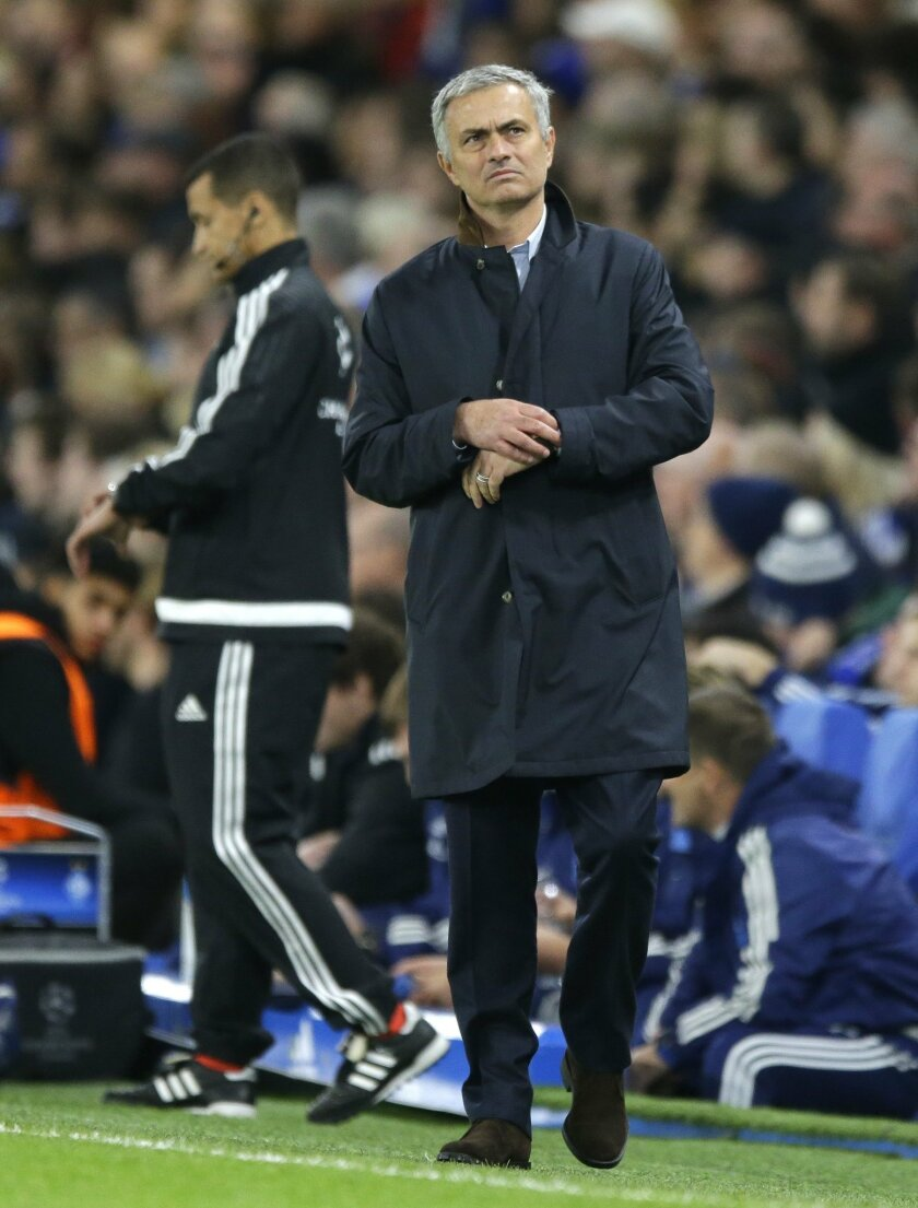 Chelsea manager Jose Mourinho checks his watch during the Champions League Group G soccer match between Chelsea and Dynamo Kiev at Stamford Bridge Stadium in London,  Wednesday, Nov. 4, 2015. (AP Photo/Matt Dunham)