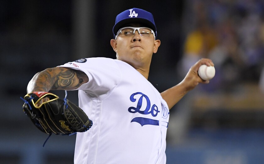Dodgers starter Julio Urias throws during the second inning of a 5-3 victory over the Colorado Rockies on Tuesday.