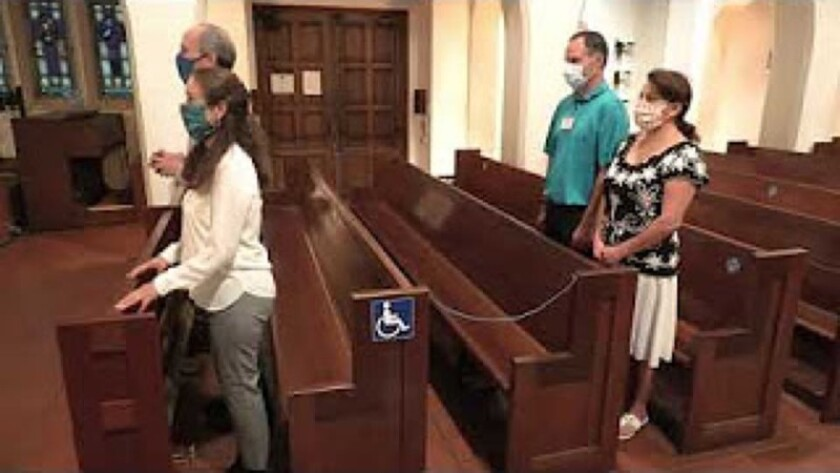 Sacred Heart Church of Ocean Beach demonstrates mask and distancing requirements for Mass in a video posted on YouTube.