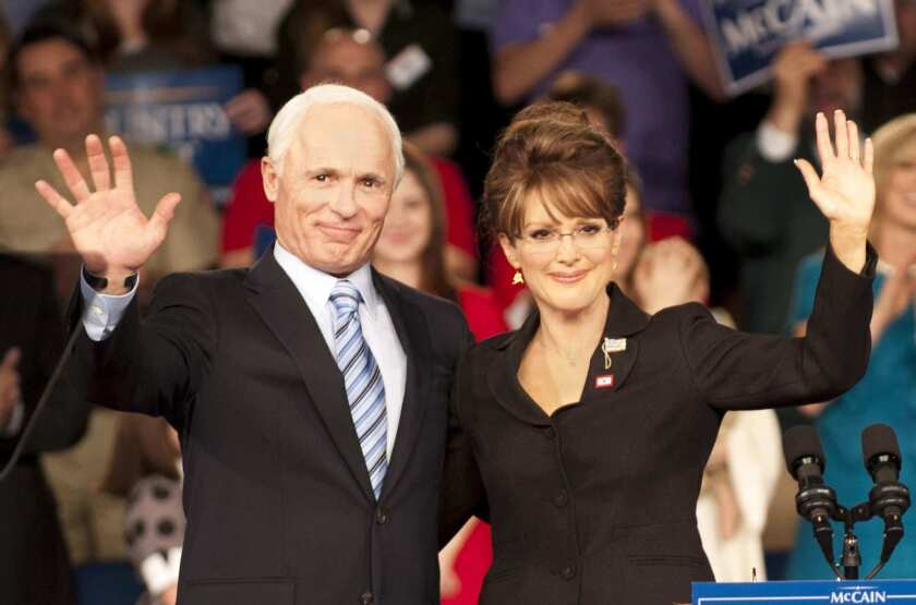 """Ed Harris as 2008 presidential hopeful John McCain and Julianne Moore as Sarah Palin wave to supporters in """"Game Change."""""""