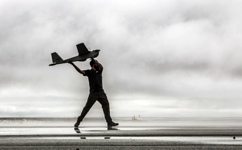 In this undated photo provided by AeroVironment, a man hand-launches a Puma drone aricraft. The Federal Aviation Administration (FAA) said Tuesday, June 10, 2014 it has granted the first permission for commercial drone flights over land, the latest effort by the agency to show it is loosening restr