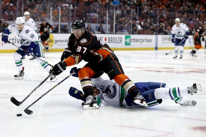 Forward Nick Ritchie (37) of the Ducks skates past Christopher Tanev of the Vancouver Canucks on Sunday.
